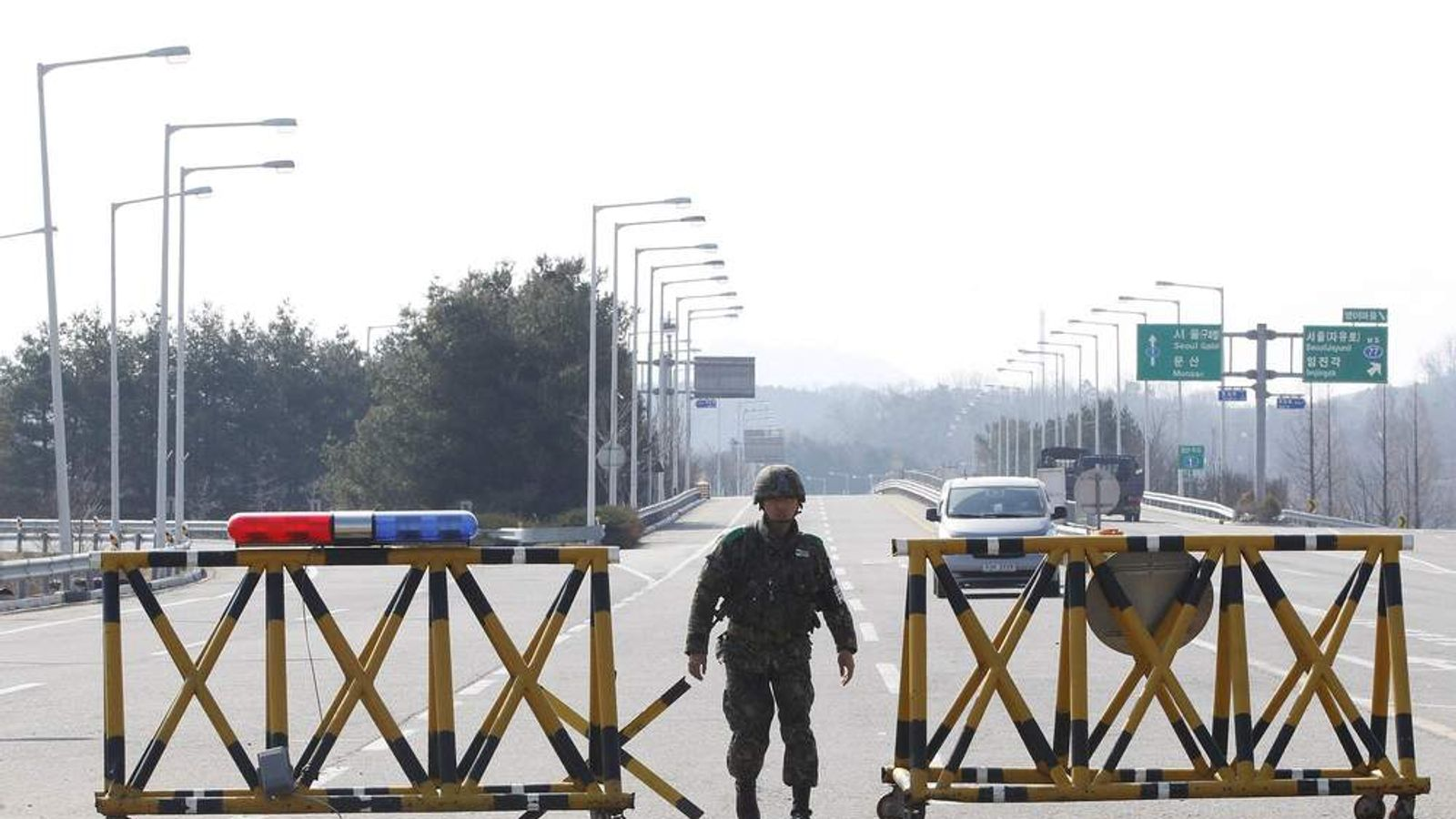 South Korean soldier guards Unification Bridge on border with North Korea