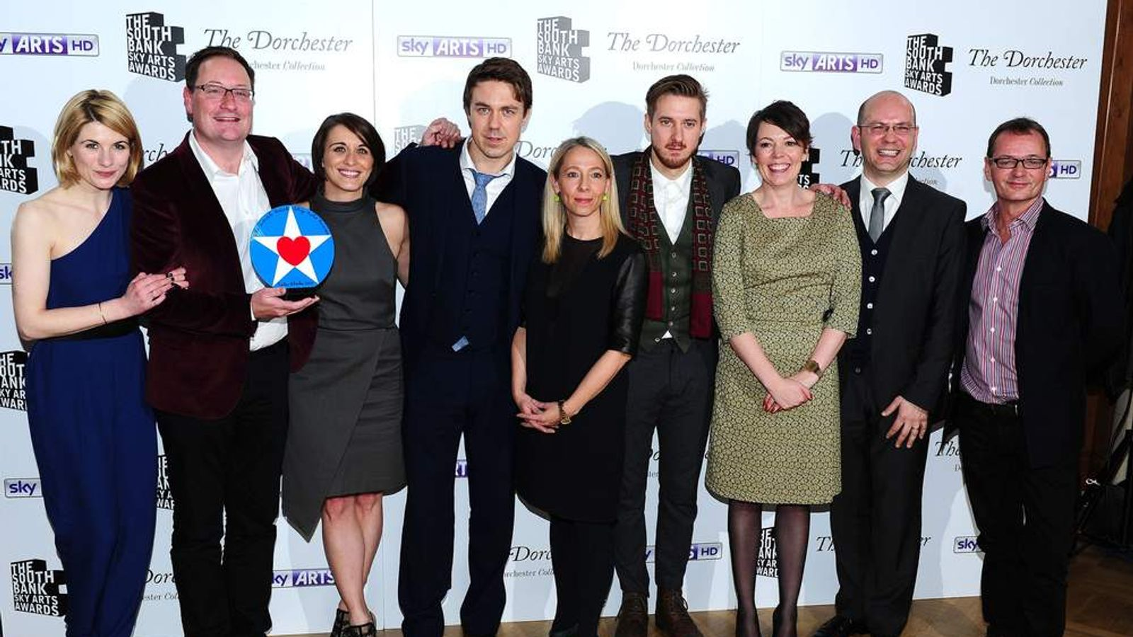 Cast and crew celebrate as Broadchurch wins the TV Drama award at the South Bank Sky Arts Awards