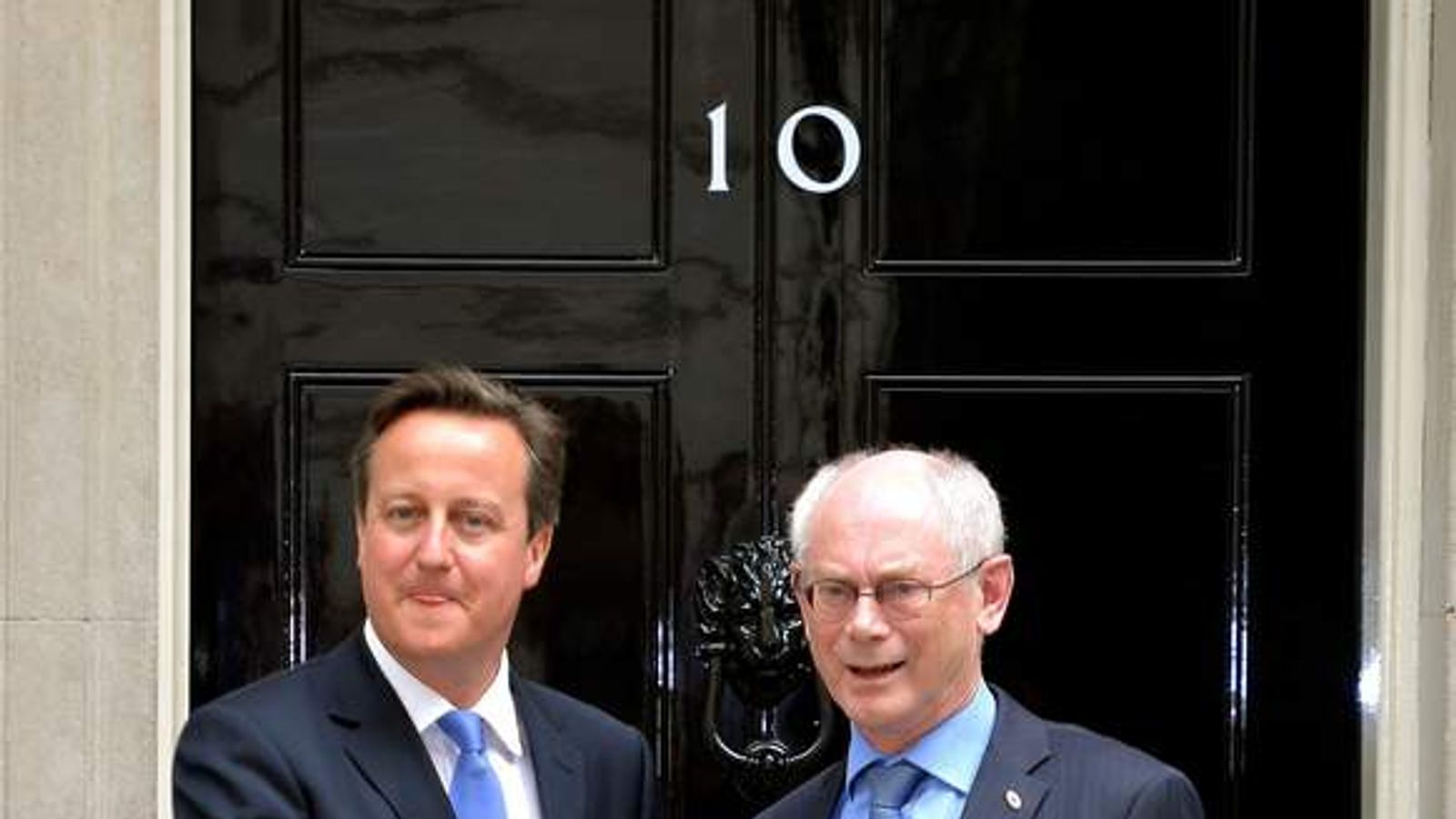 Prime Minister David Cameron greets  Herman Van Rompuy, President of the European Council, on the steps of number 10, Downing Street in Westminster.