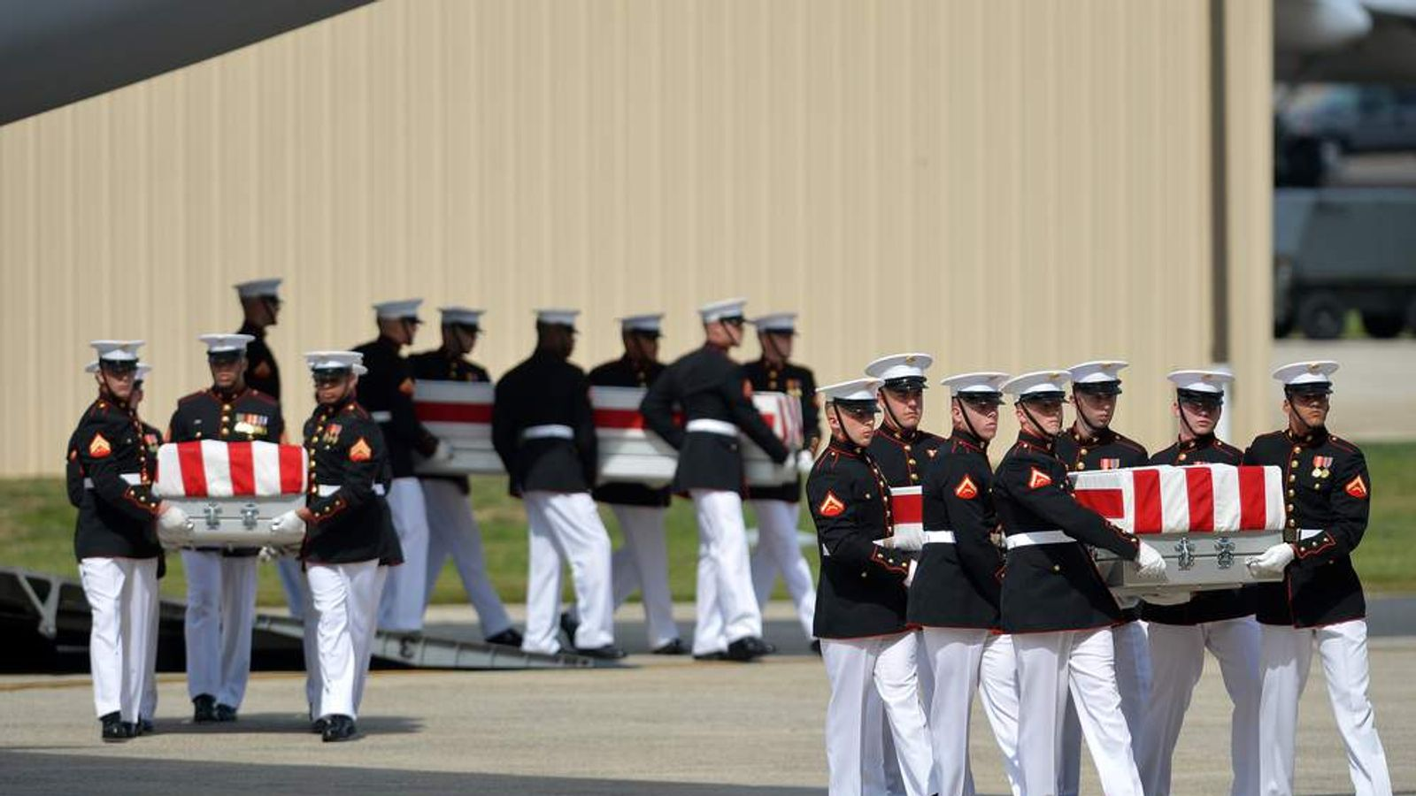 Remains of four Americans return to US including ambassador in Libya