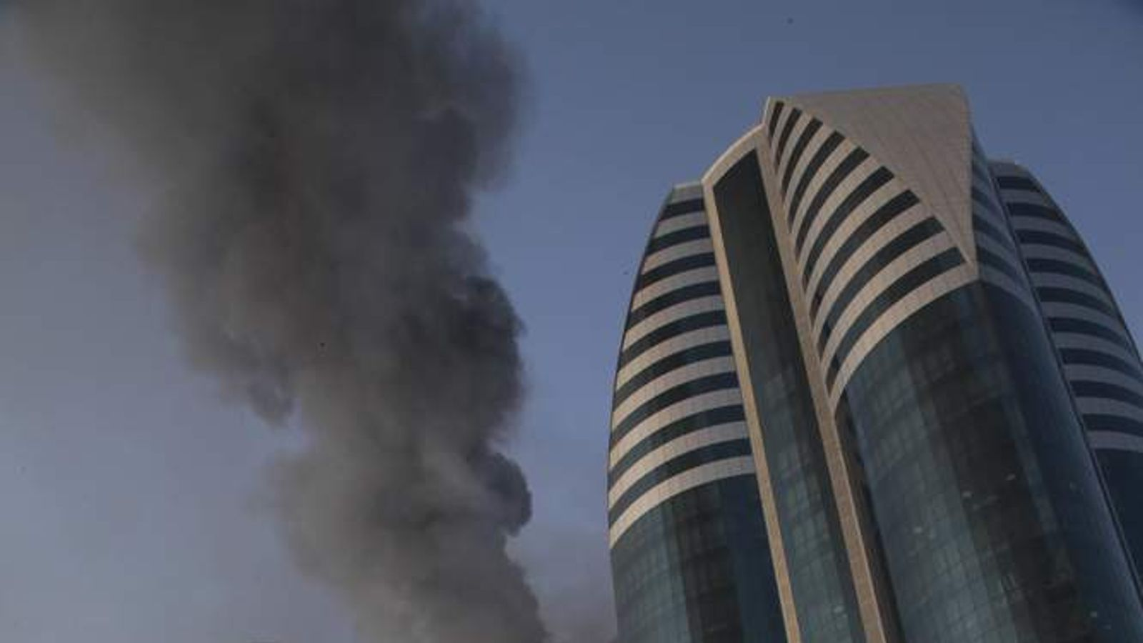 A fire rages in a high-rise apartment building in provincial capital Grozny, Russia