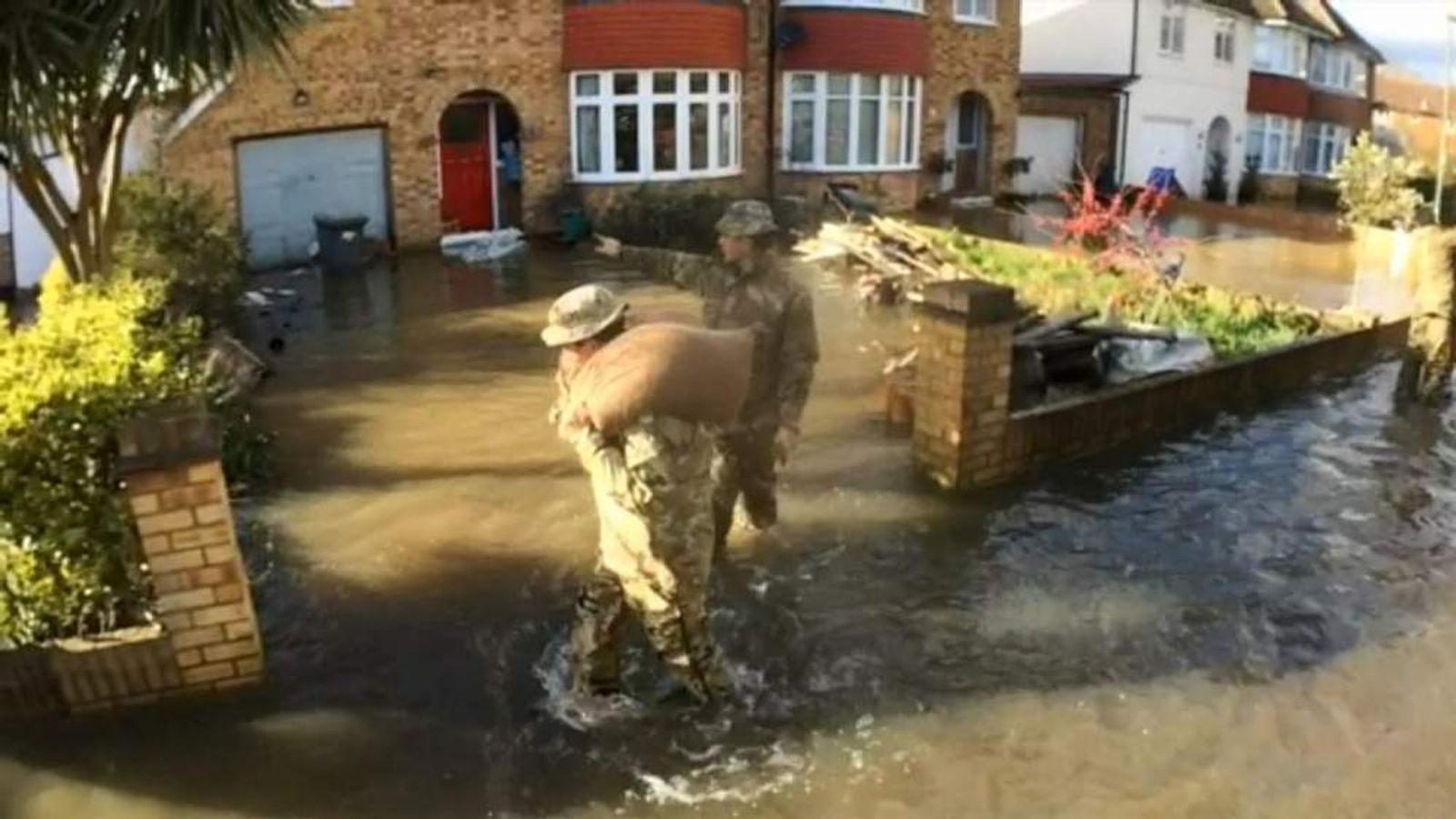 Soldiers deliver sandbags to homes in Staines