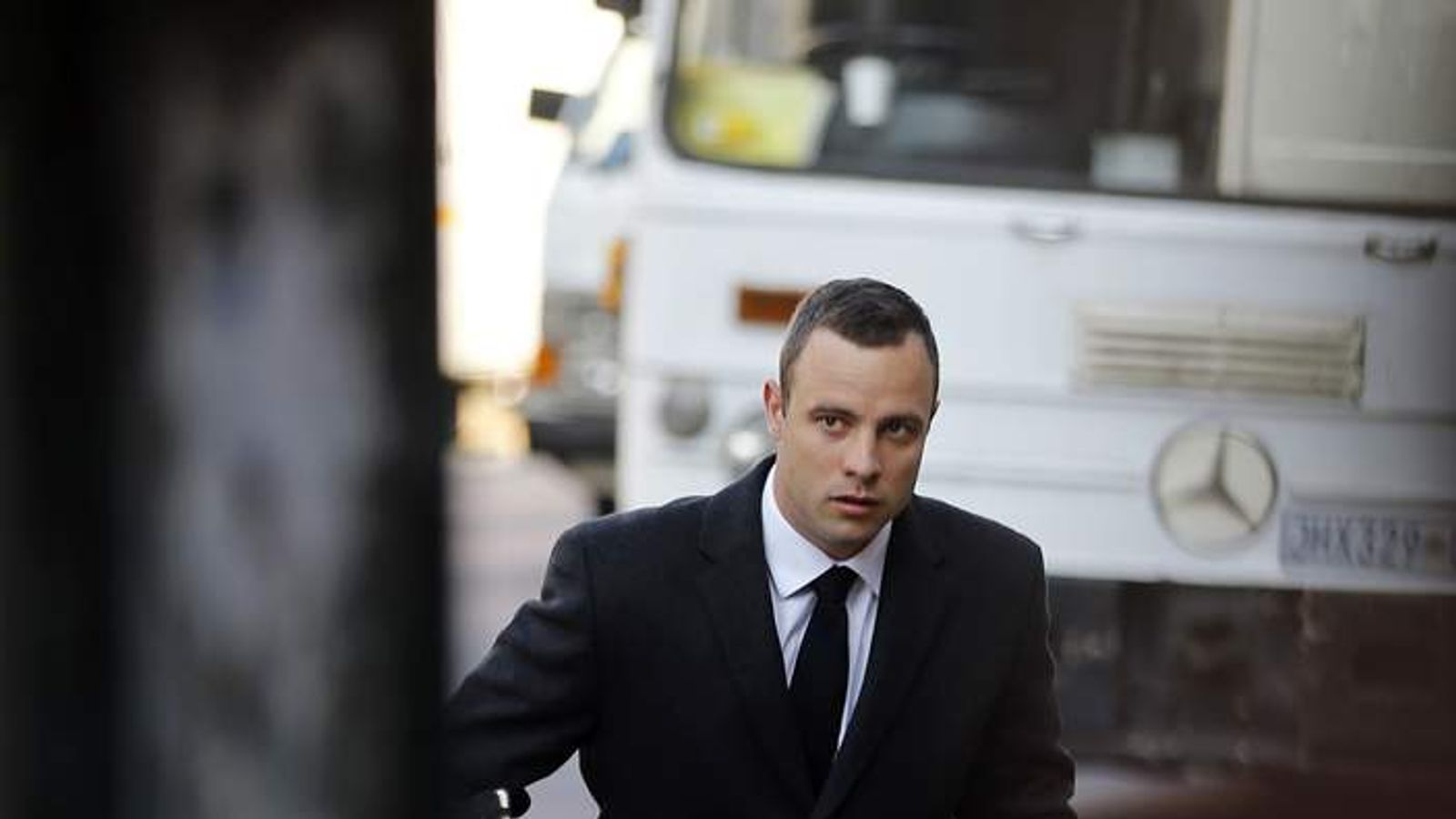 Olympic and Paralympic track star Oscar Pistorius arrives ahead of his trial for the murder of his girlfriend Reeva Steenkamp