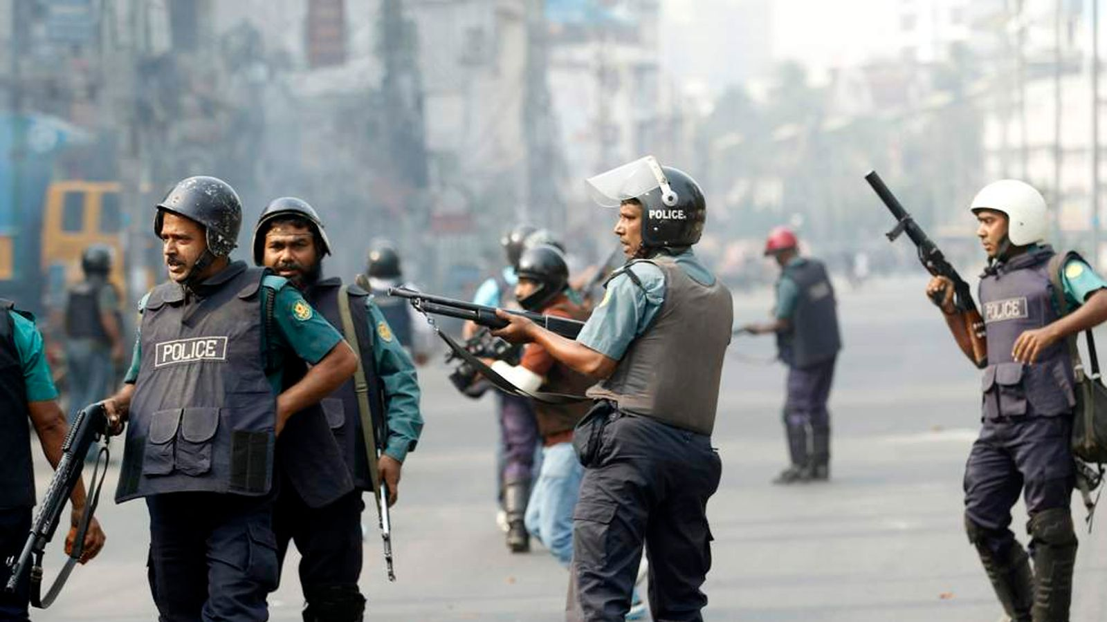 Members of police fire rubber bullets during a clash with the activists of Bangladesh Jamaat-E-Islami in Dhaka