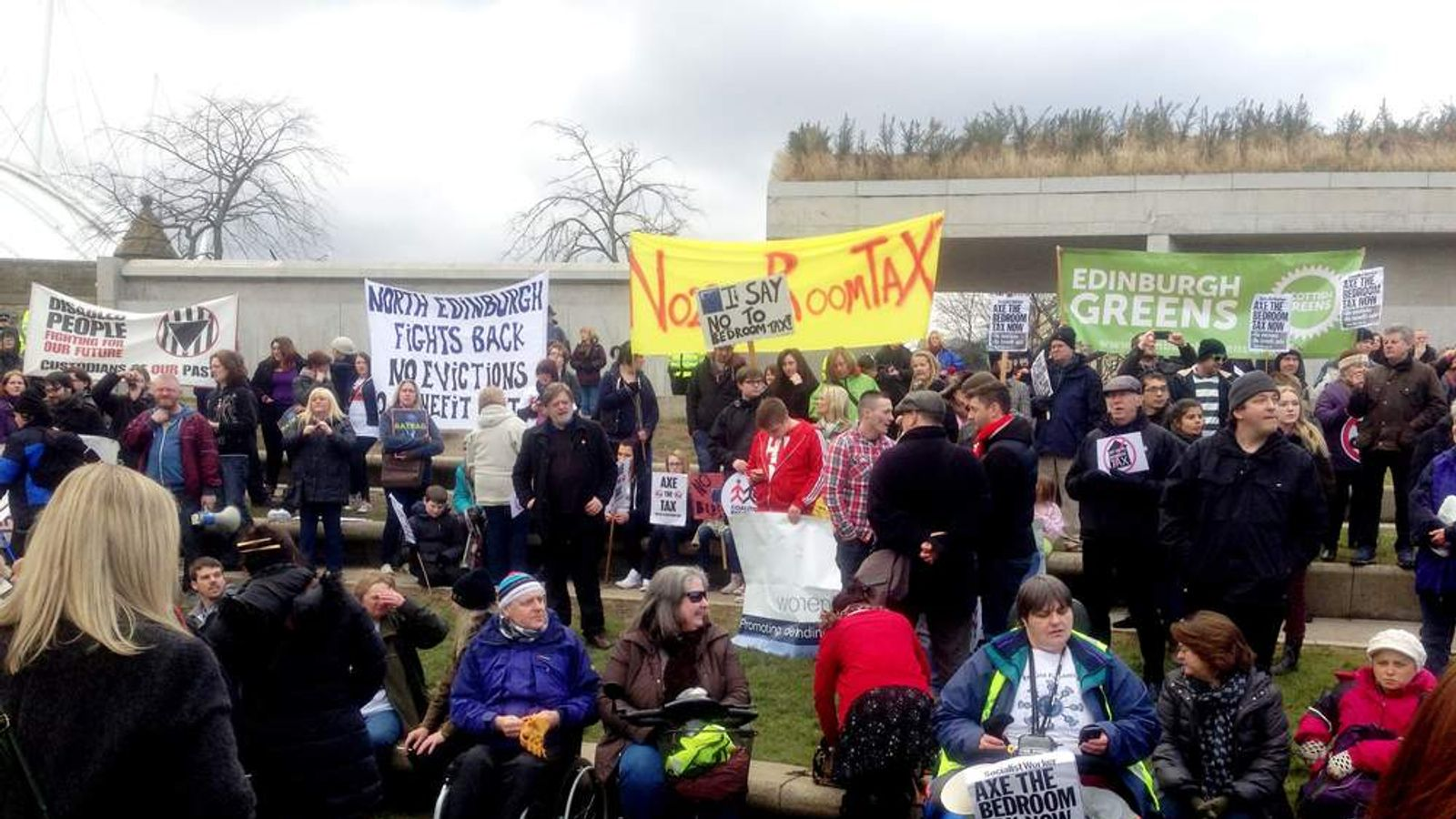 People march the streets of Edinburgh in a protest over cuts to housing benefits