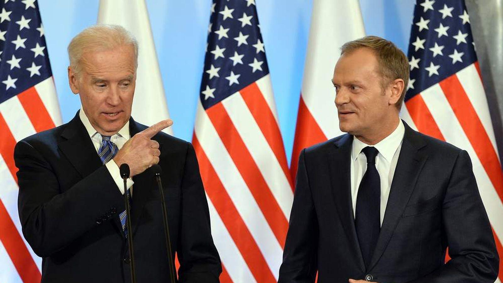 Joe Biden (L) meets Donald Tusk