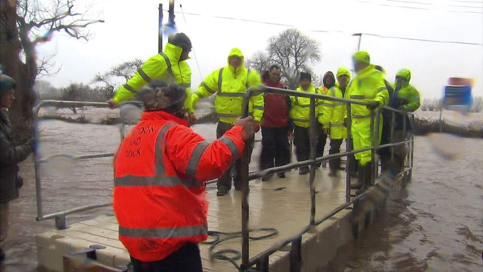 Volunteers build a pontoon to travel across Somerset Levels
