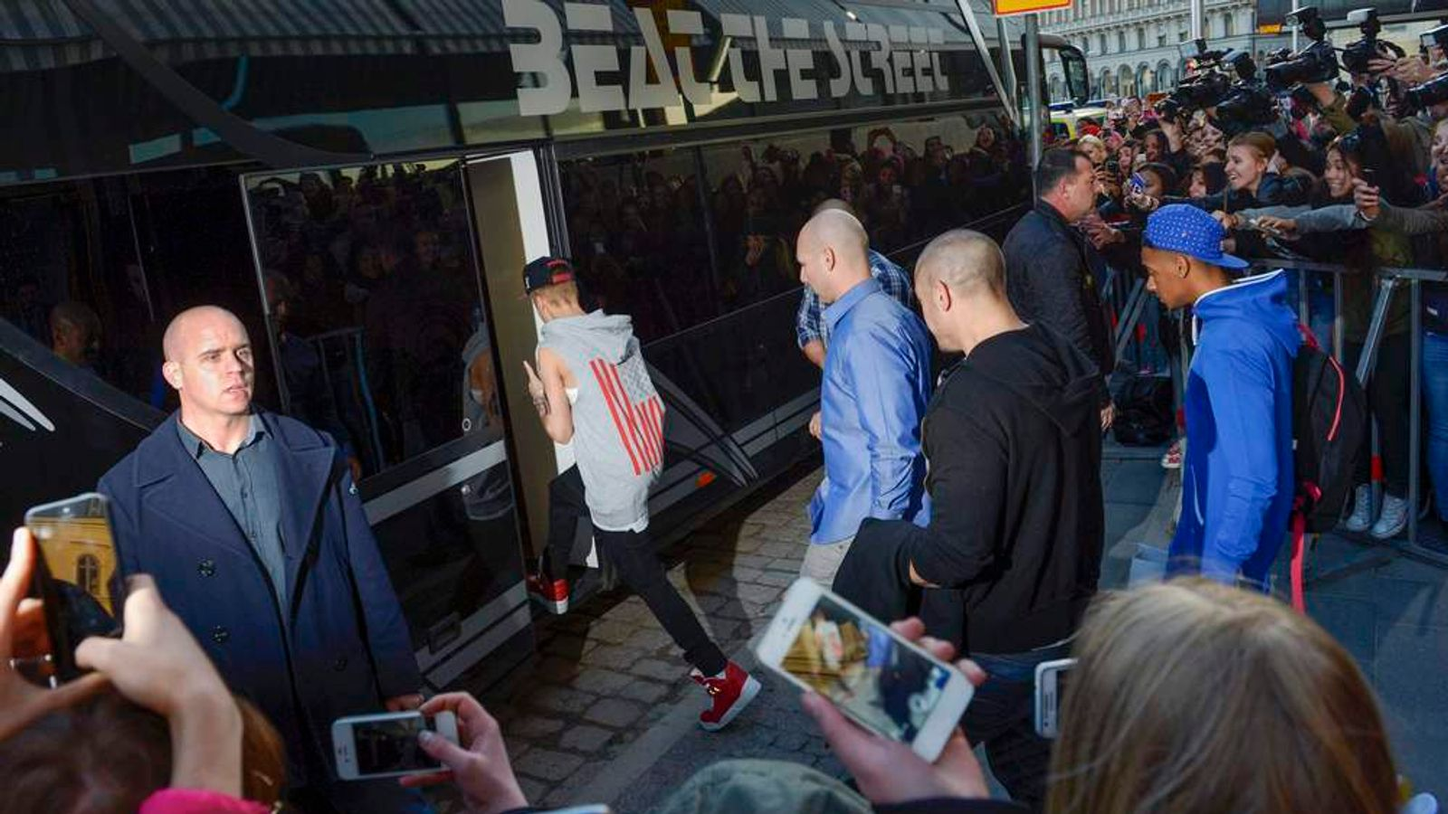 A file picture shows pop singer Bieber as he boards his tour bus outside Grand Hotel for his concert in Stockholm