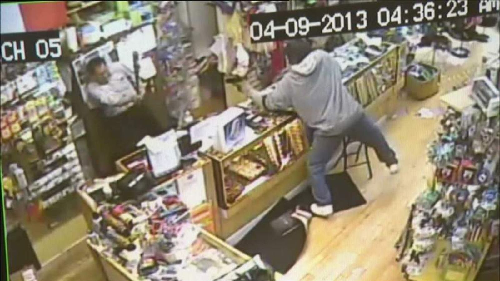 Chicago shop armed raid owner fights back with baseball bat