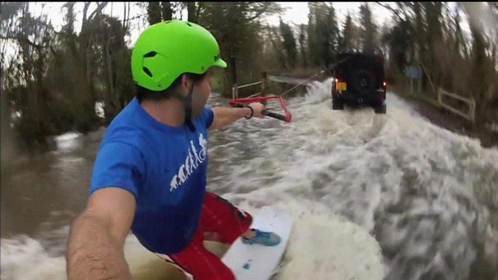 Wakeboarder rides in floods in Godalming, Surey