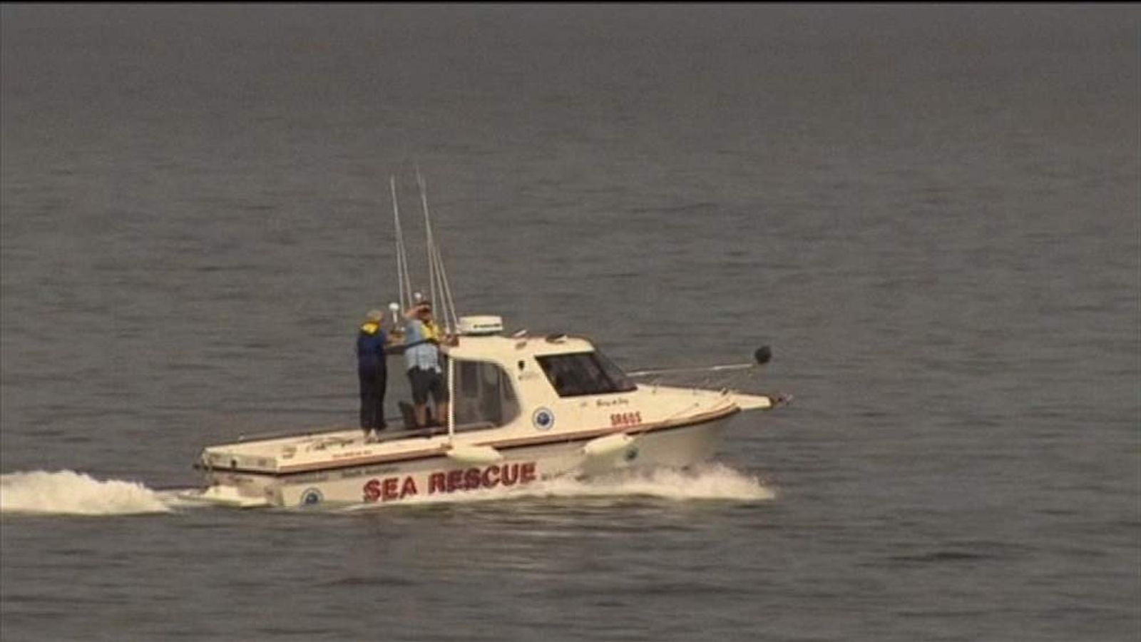 A sea rescue boat searches for a man killed by a shark while spear fishing.