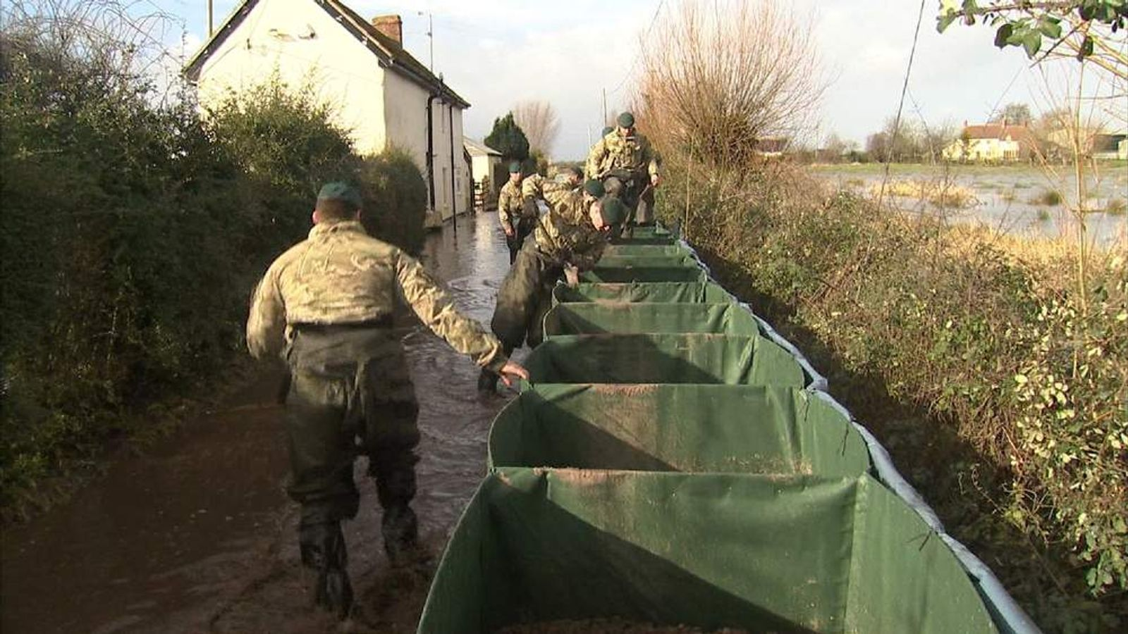 Members of the armed forces help to build flood defences in Somerset