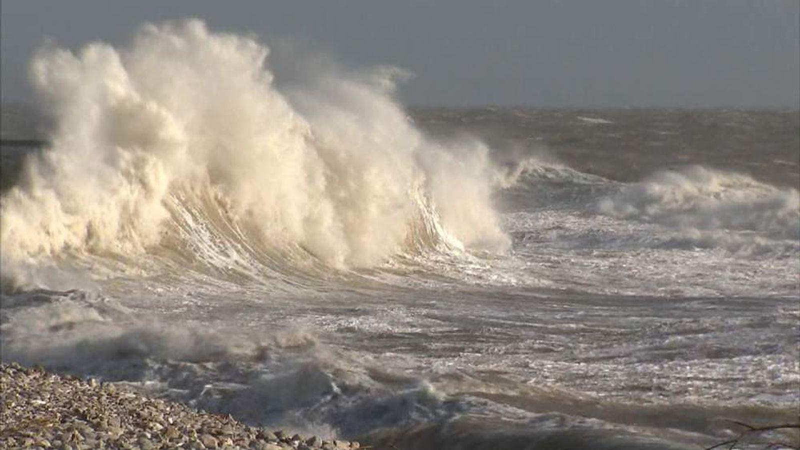 Waves crash against The Cobb at Lyme Regis