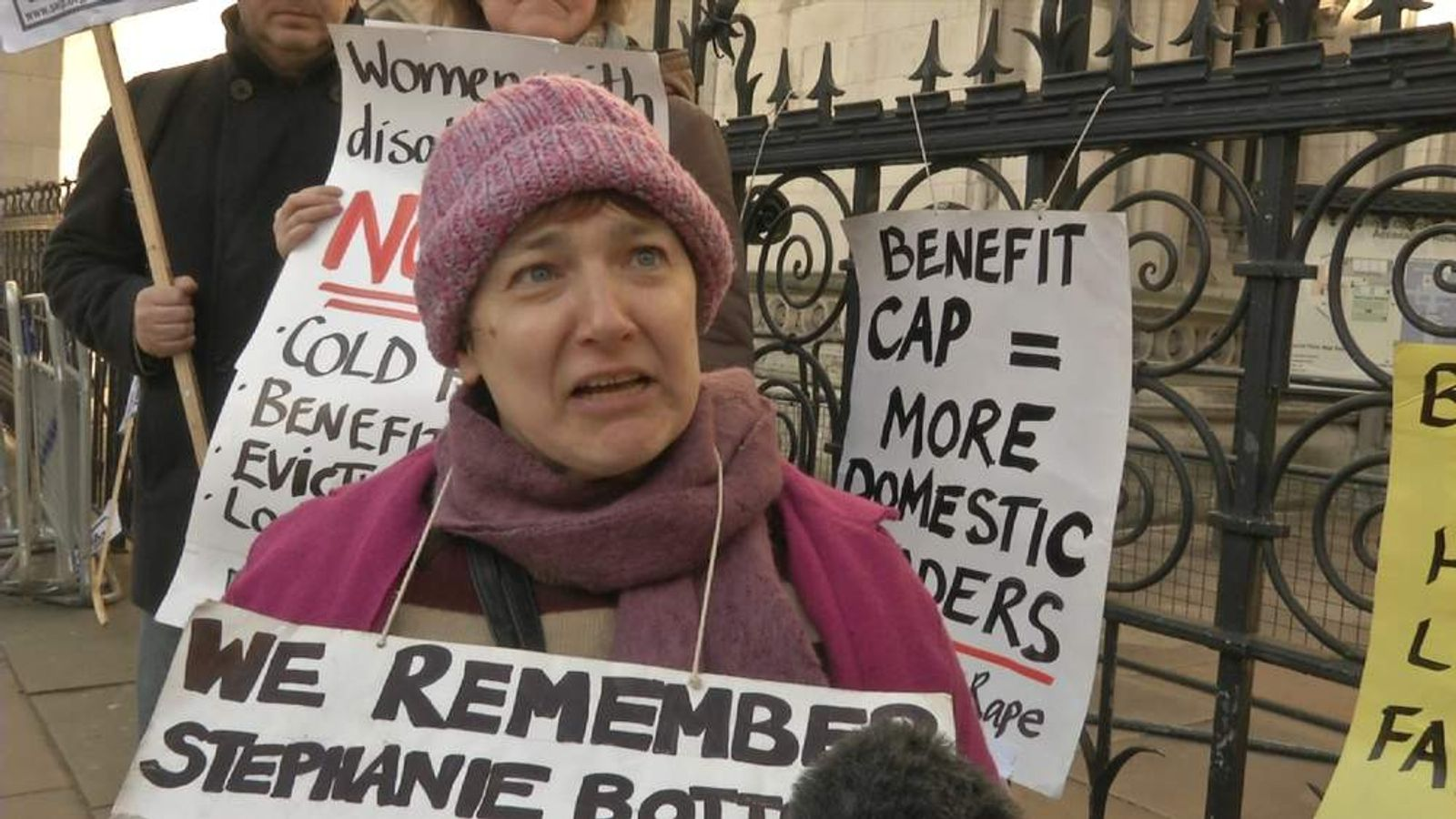 An anti-bedroom tax protester outside the court