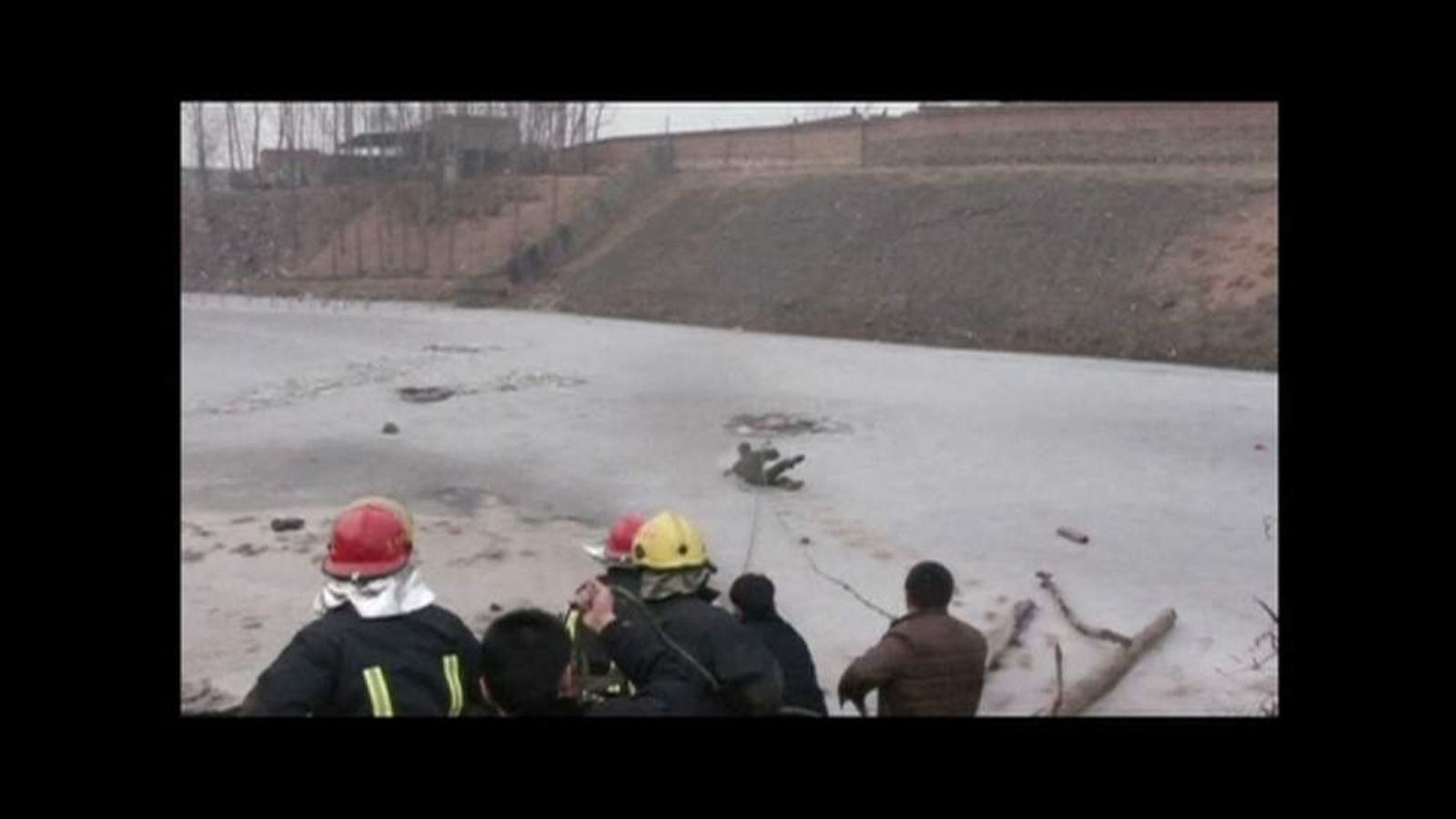 Rescue worker falls into frozen river in China while trying to find six missing children