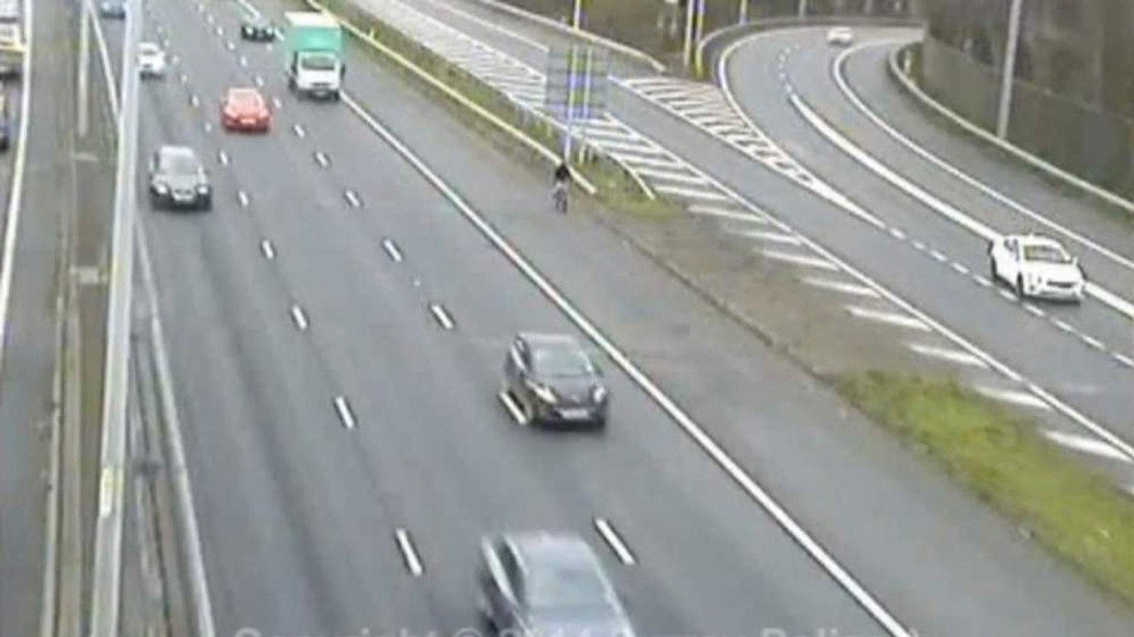 Cyclist rides along M25 as a shortcut