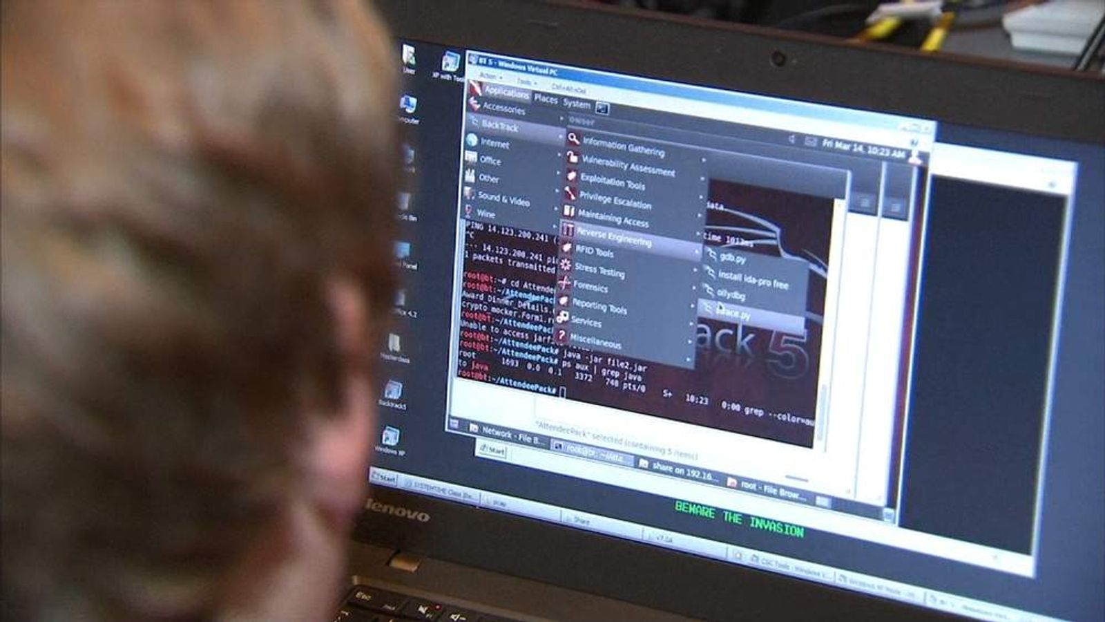 A student looks at a screen during a simulated cyber attack