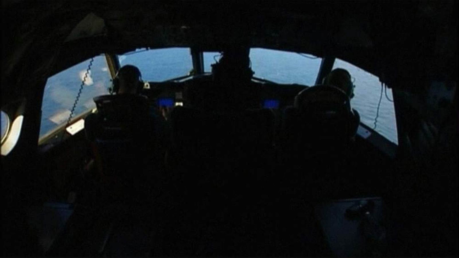Members of Australia's Air Force search for debris from missing airliner MH370.