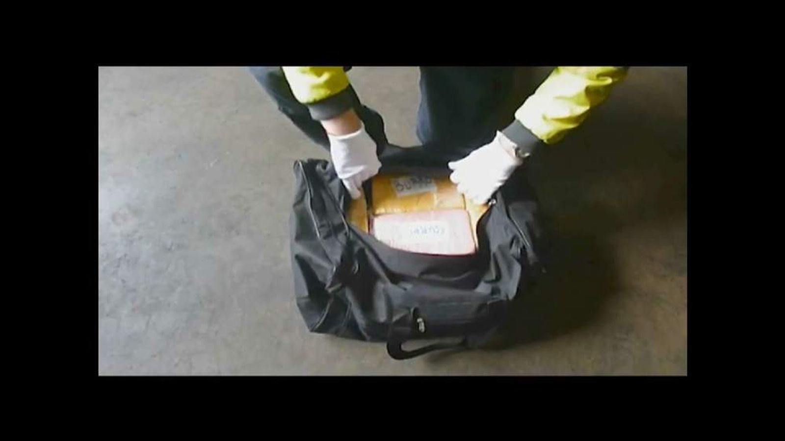 Opened Bag Reveals Sealed Boxes Containing Cocaine