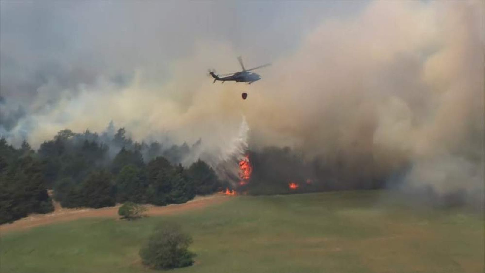 Blackhawk helicopters drop water on Oklahoma wildfires