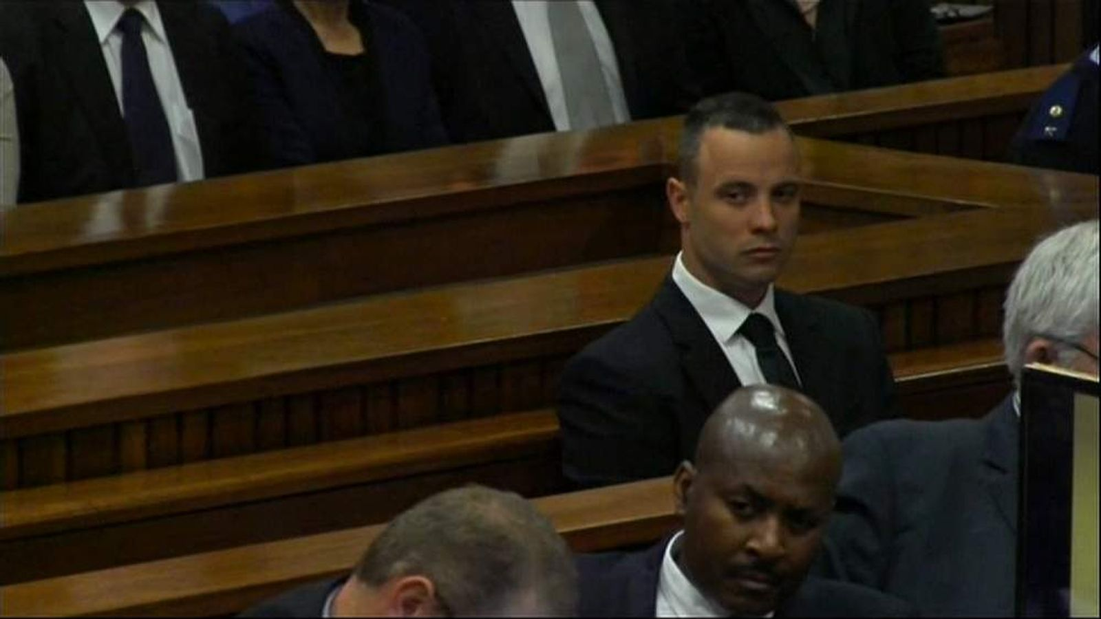 Oscar Pistorius listens to witness Professor Christina Lundgren