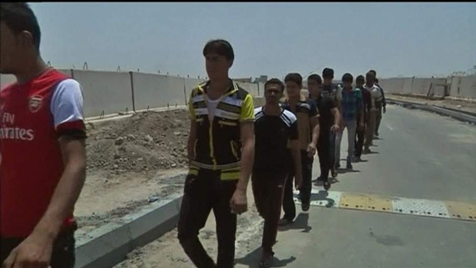 120614 IRAQ basra queue phone screengrab