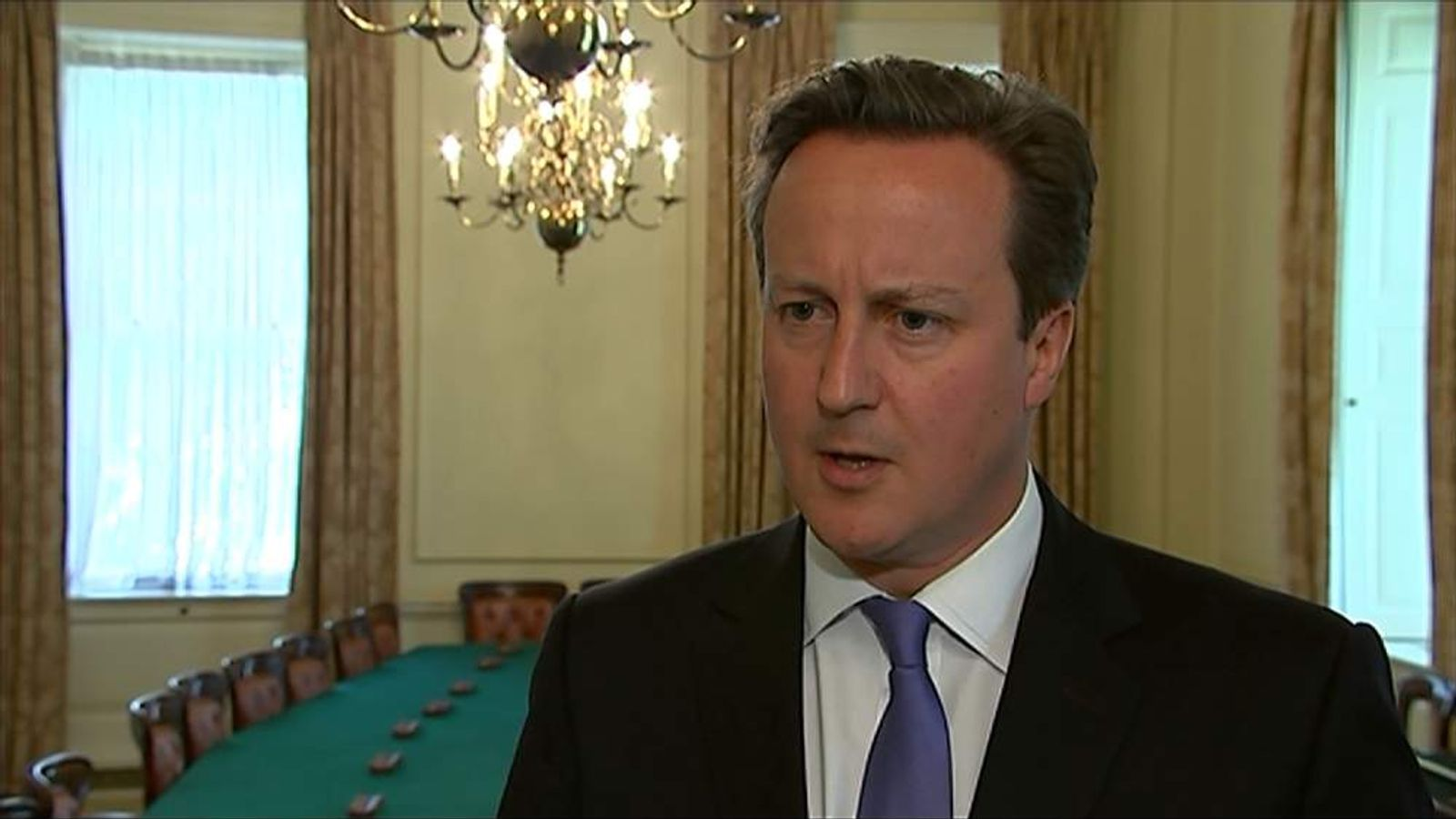 Prime Minister David Cameron apologises for hiring Andy Coulson