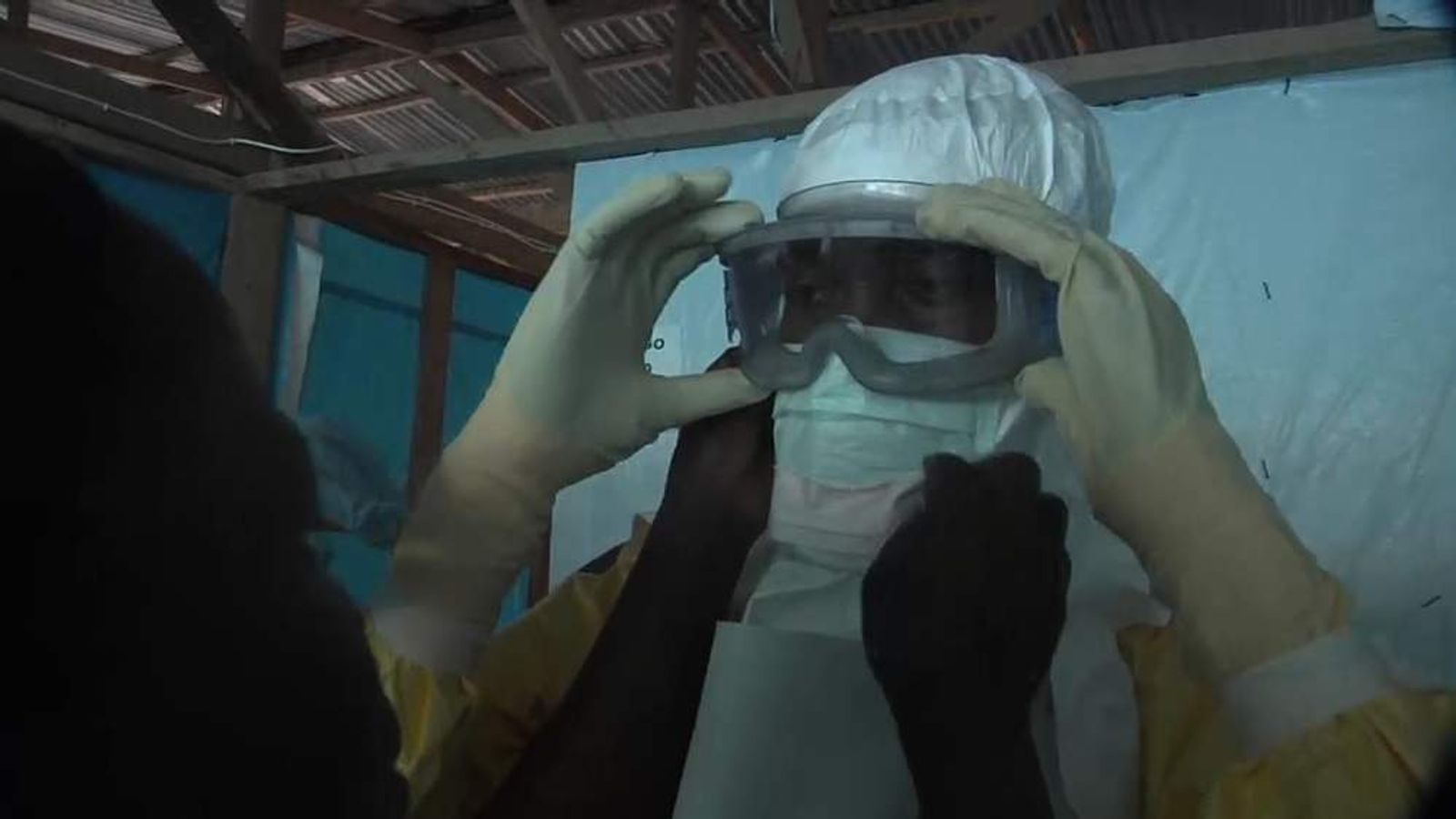 UNICEF workers prepare to enter the infection zone