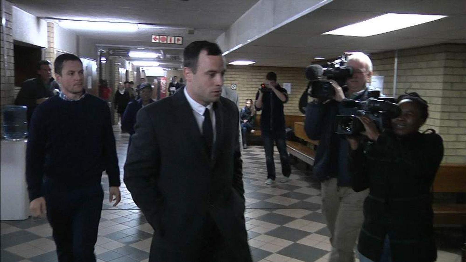 Oscar Pistorius arrives at court in Pretoria