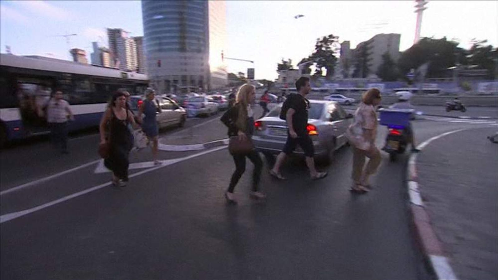 People running in the streets of Tel Aviv