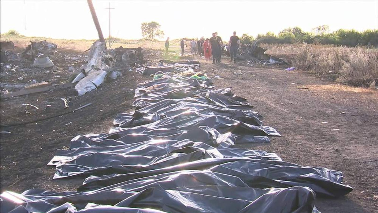 Body bags lined up at the scene of the MH17 crash in eastern Ukraine.