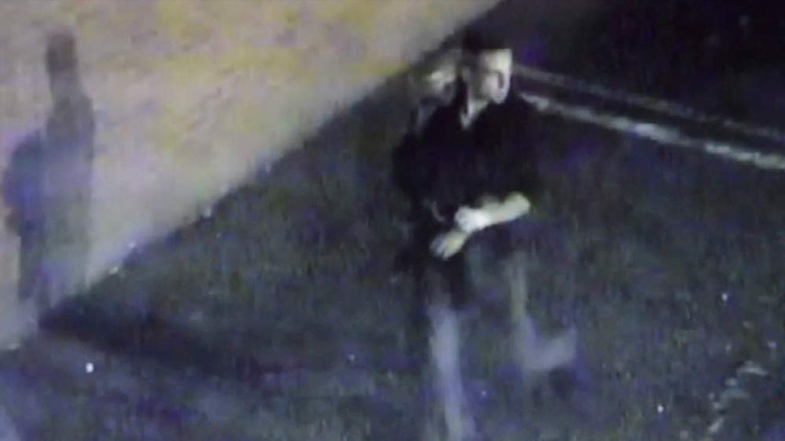 The wanted suspect is seen removing his gloves in CCTV footage