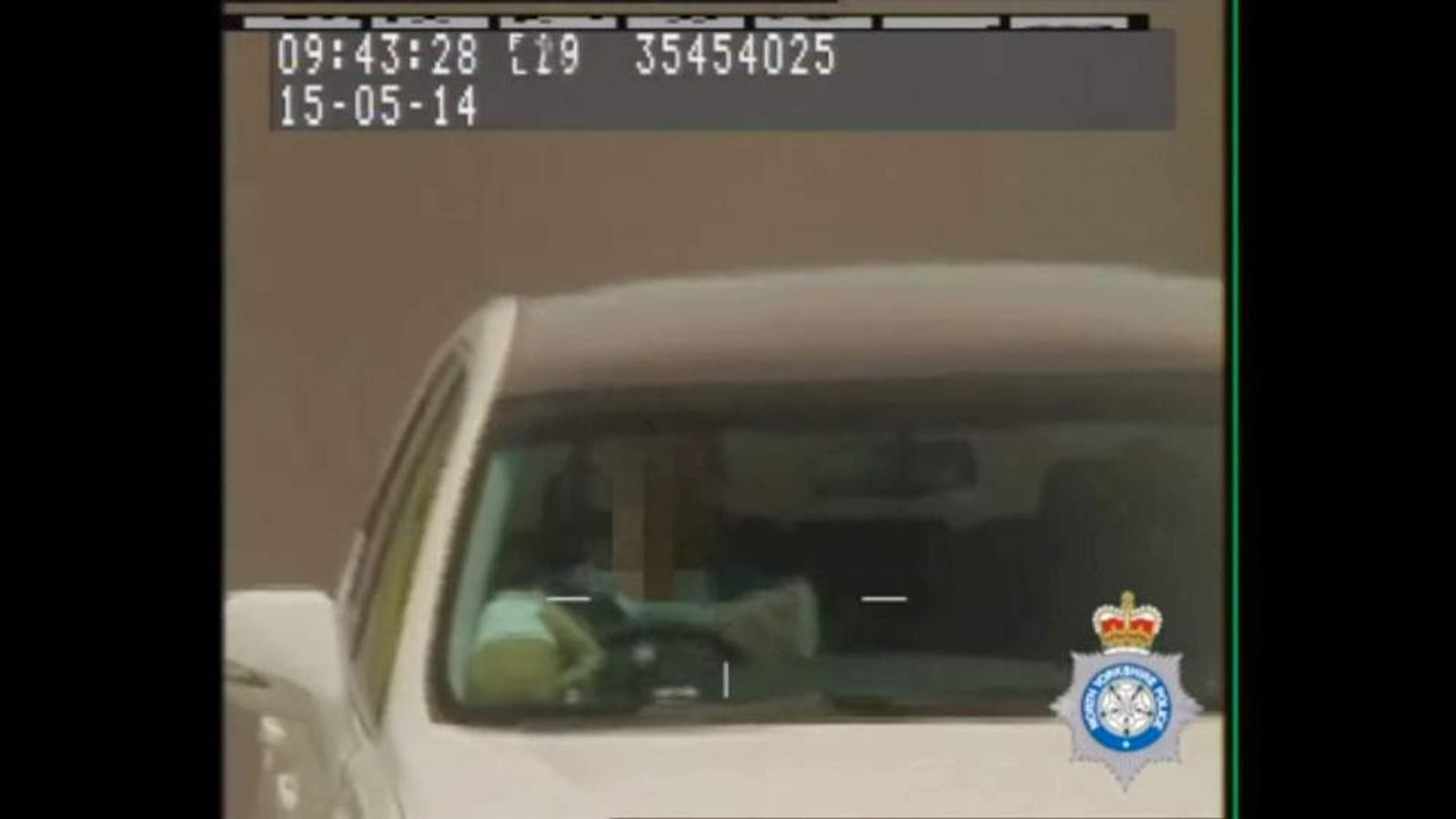 A driver caught on a Yorkshire police camera reading a newspaper