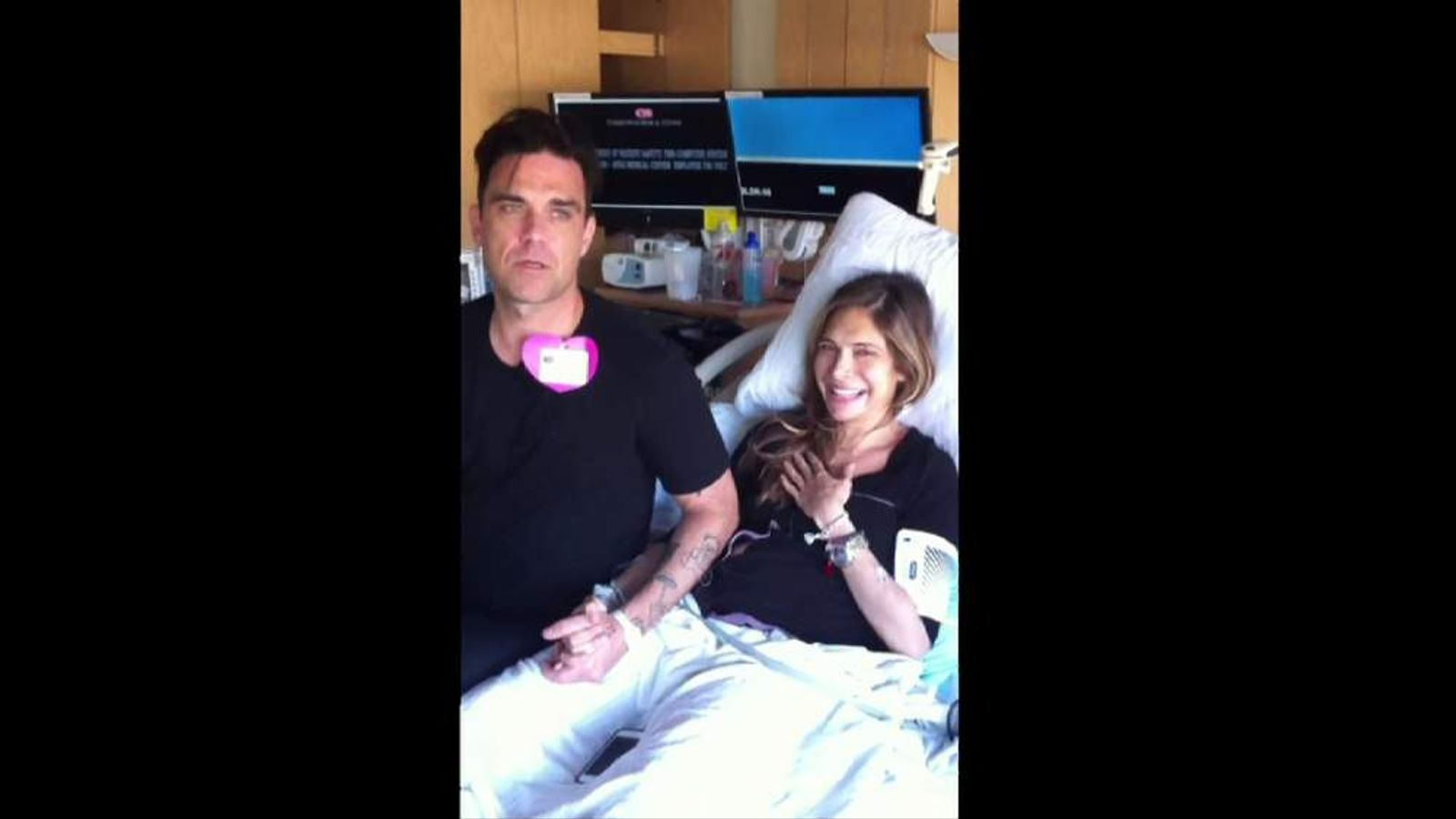 Robbie Williams and wife Ayda after the birth of their son 2