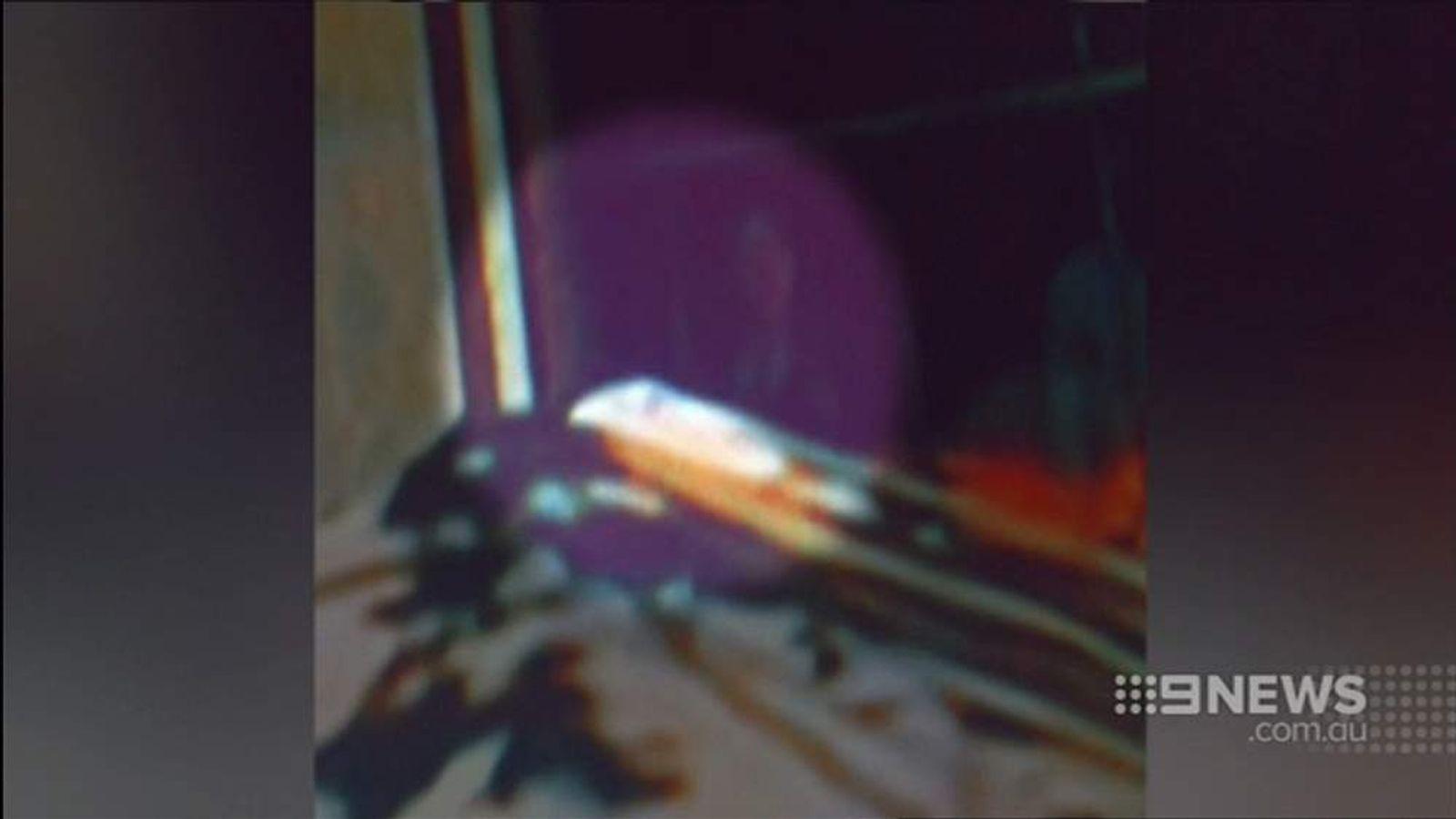 Sydney Siege Hostage draws finger across throat