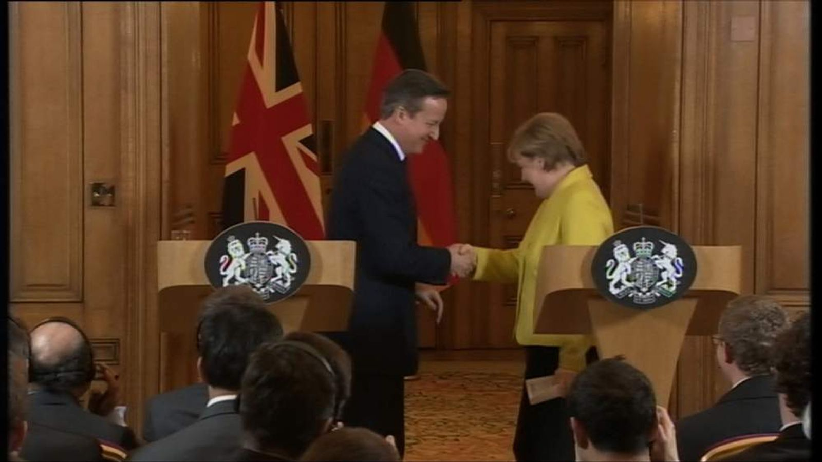 Cameron and Merkel shake hands after Downing Street news conference