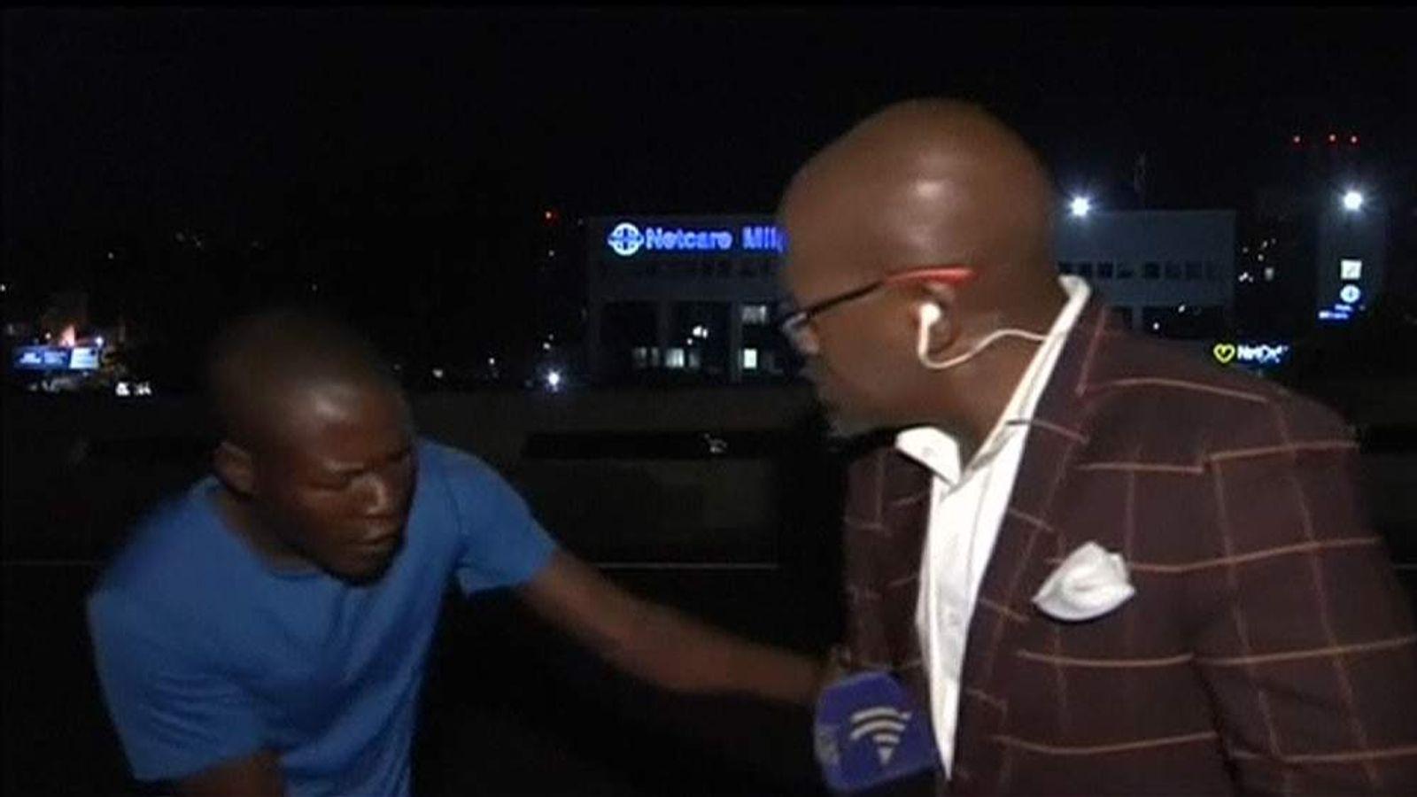 South Africa SABC reporter mugged on camera