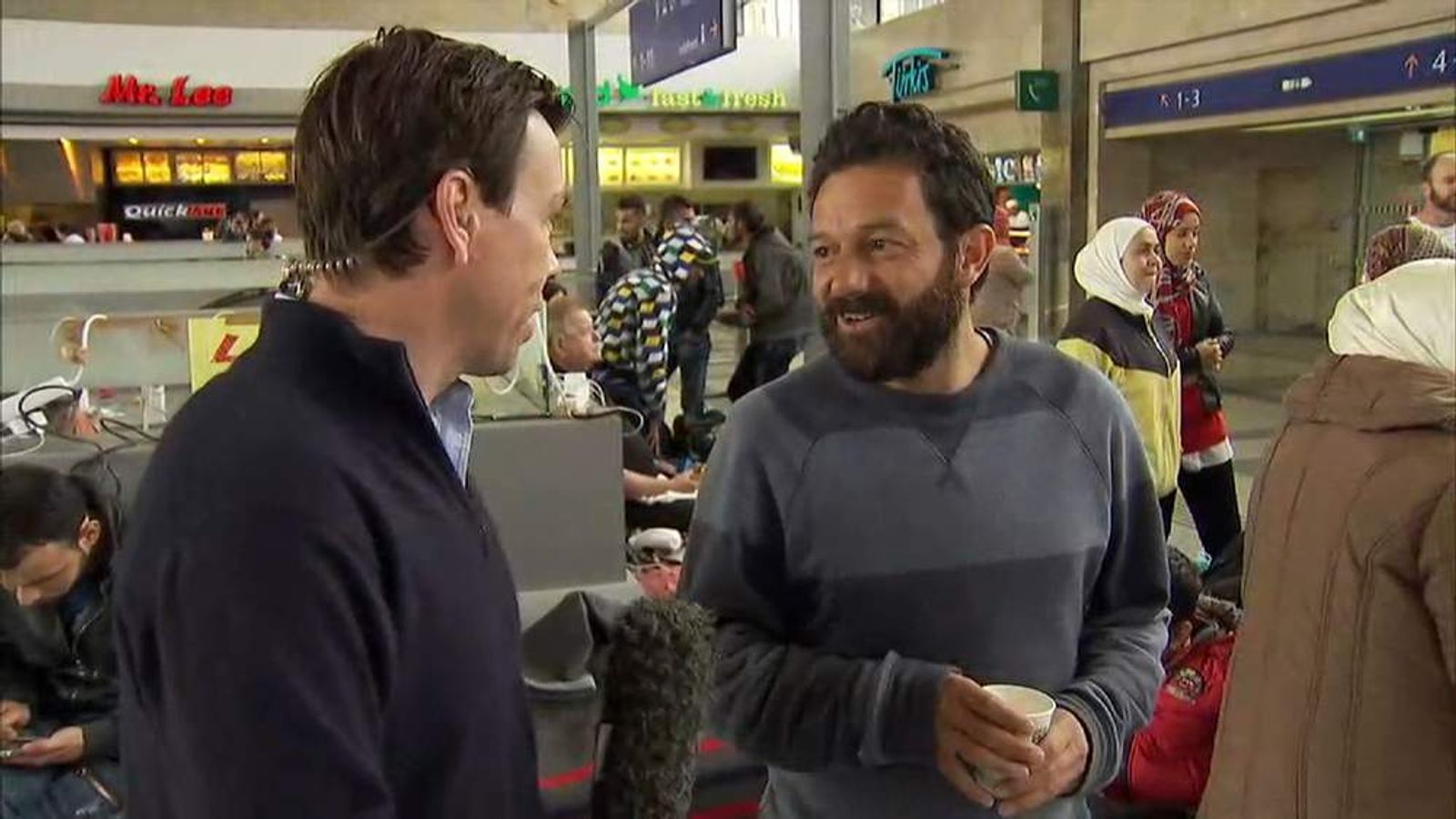 Sky News' Mark Stone is stopped by a Syrian man who wants to thank Austria
