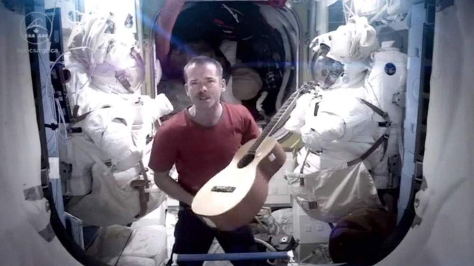 Nasa astronaut plays guitar