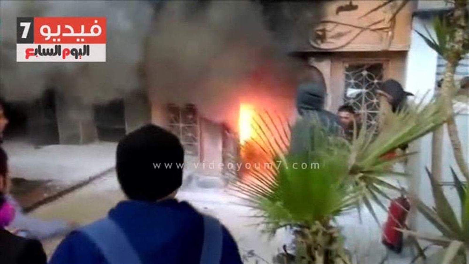 Smoke pours out of a restaurant in Cairo after it was firebombed.