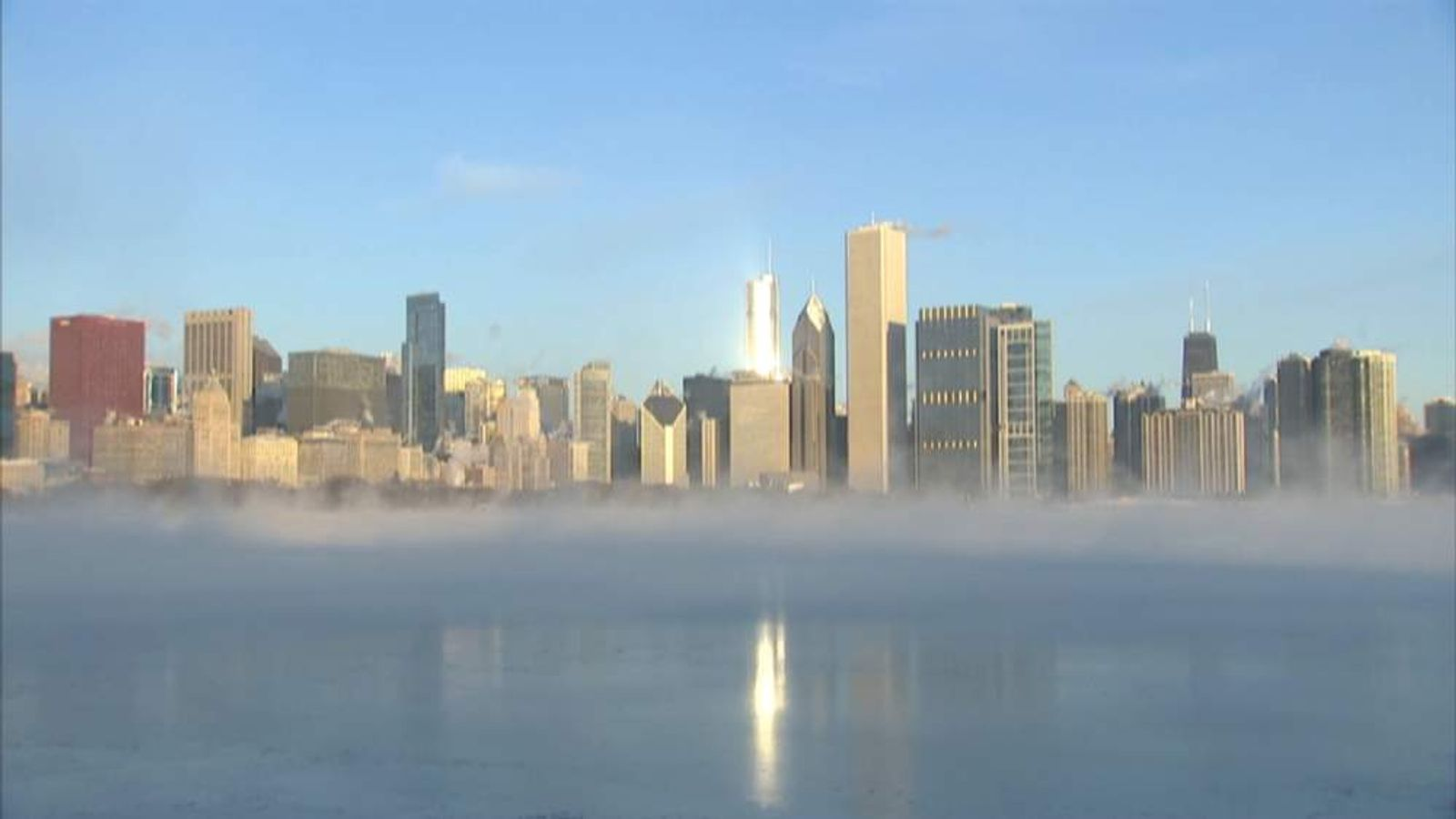Vapours rise from the frozen surface of Lake Michigan