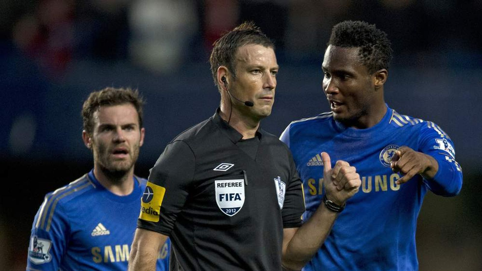 John Mikel Obi talking with referee Mark Clattenburg