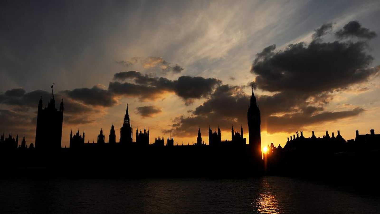 The sun sets behind Britain's Houses of