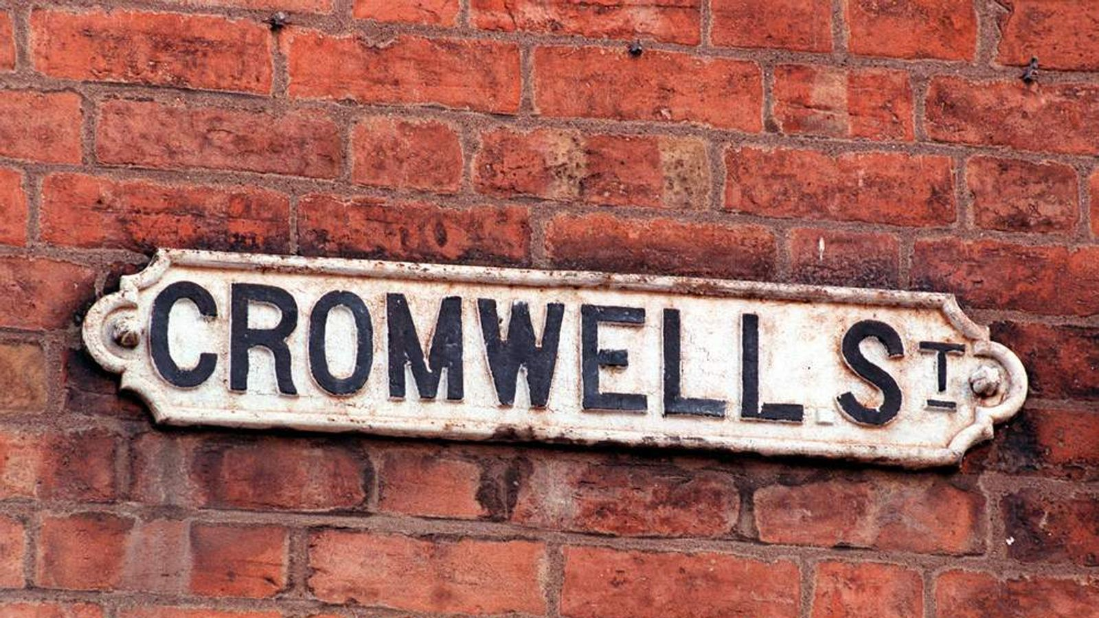 The sign on the wall in Cromwell Street, Gloucester, where Fred West lived.