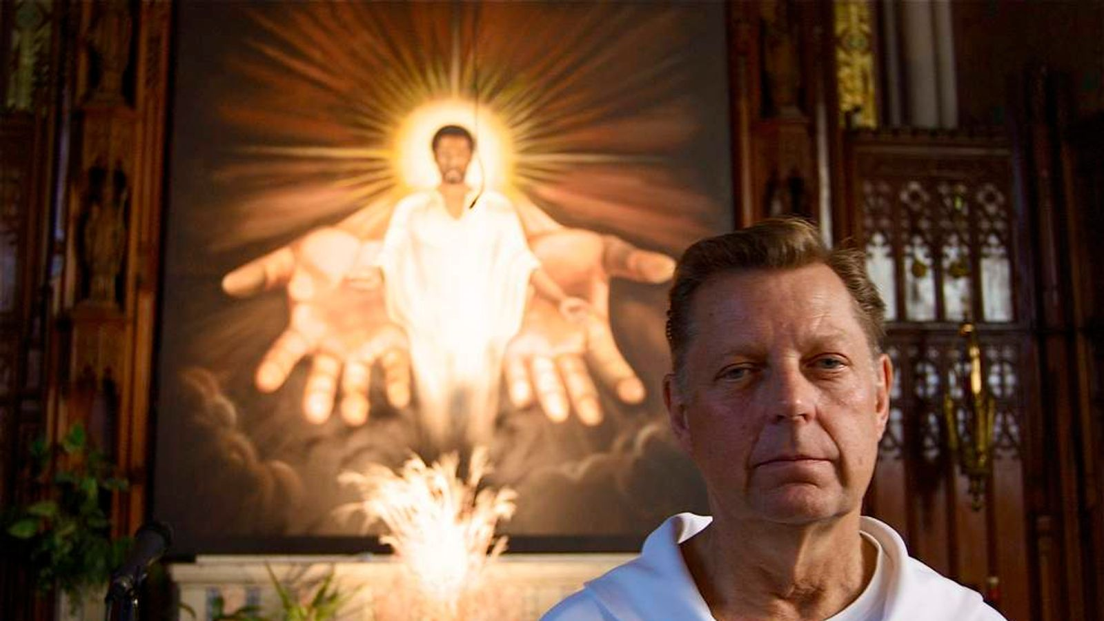 Father Michael Pfleger has campaigned against assault weapons.