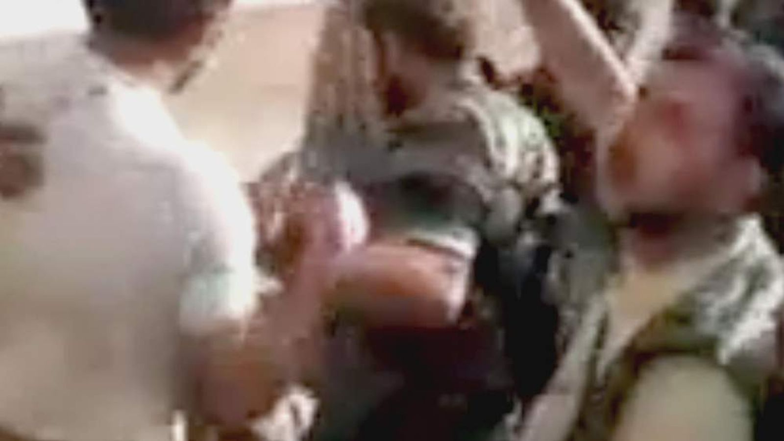 Video apparently shows Syrian rebels leading pro-government militia fighters to their deaths