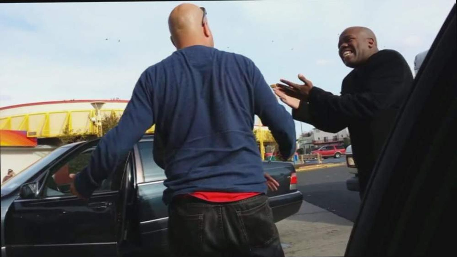 Two men argue at a petrol station