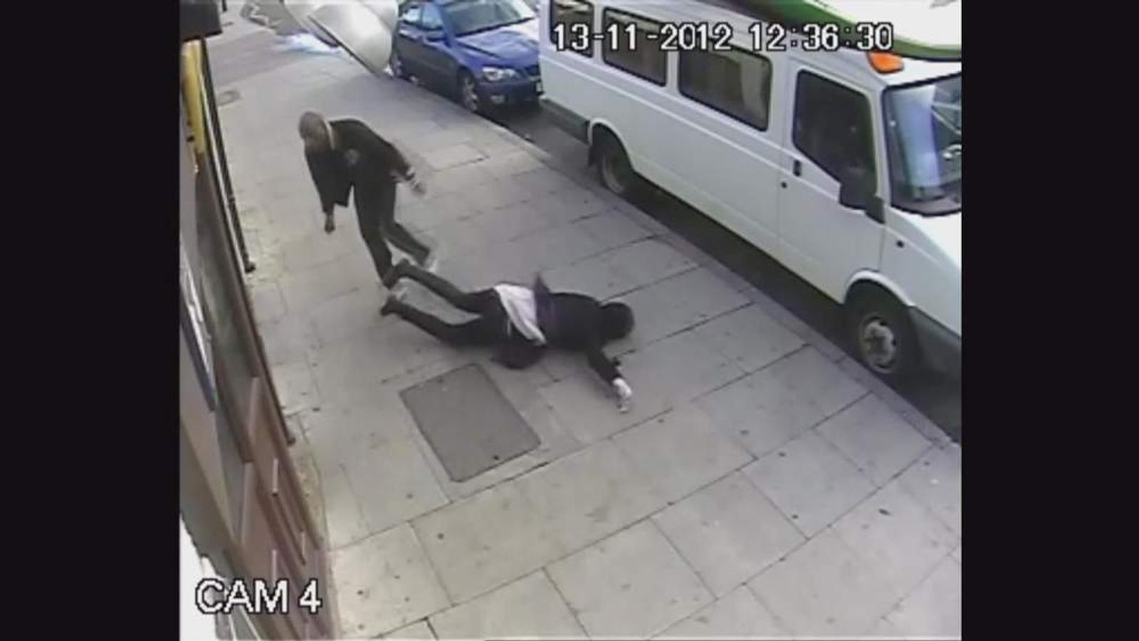 The woman is knocked to the ground by her attacker