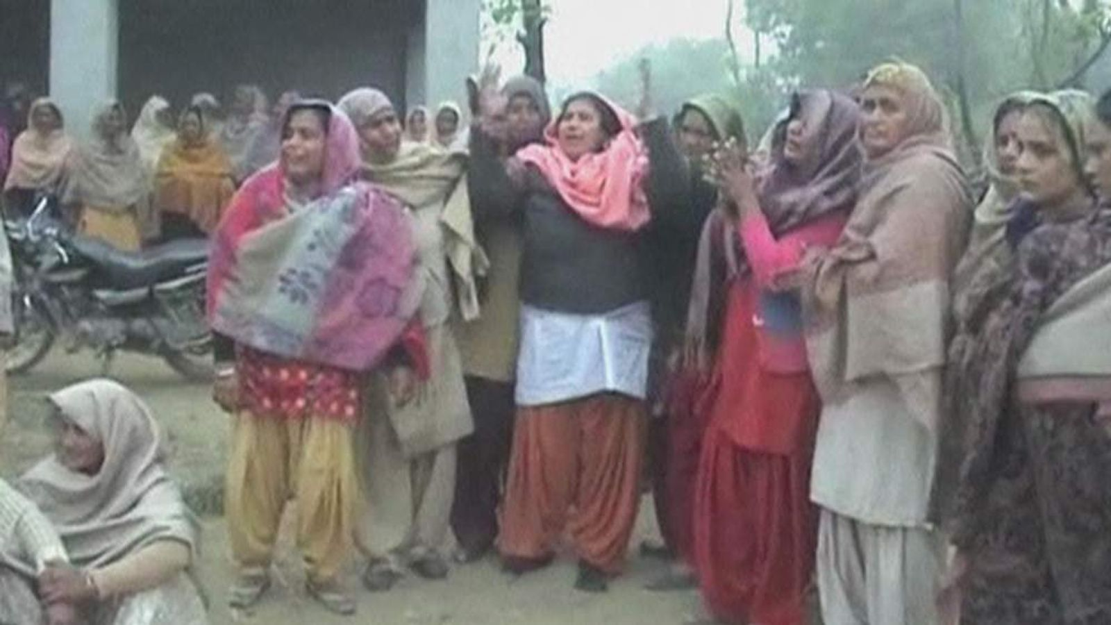 Women cry after rape victim kills herself in India