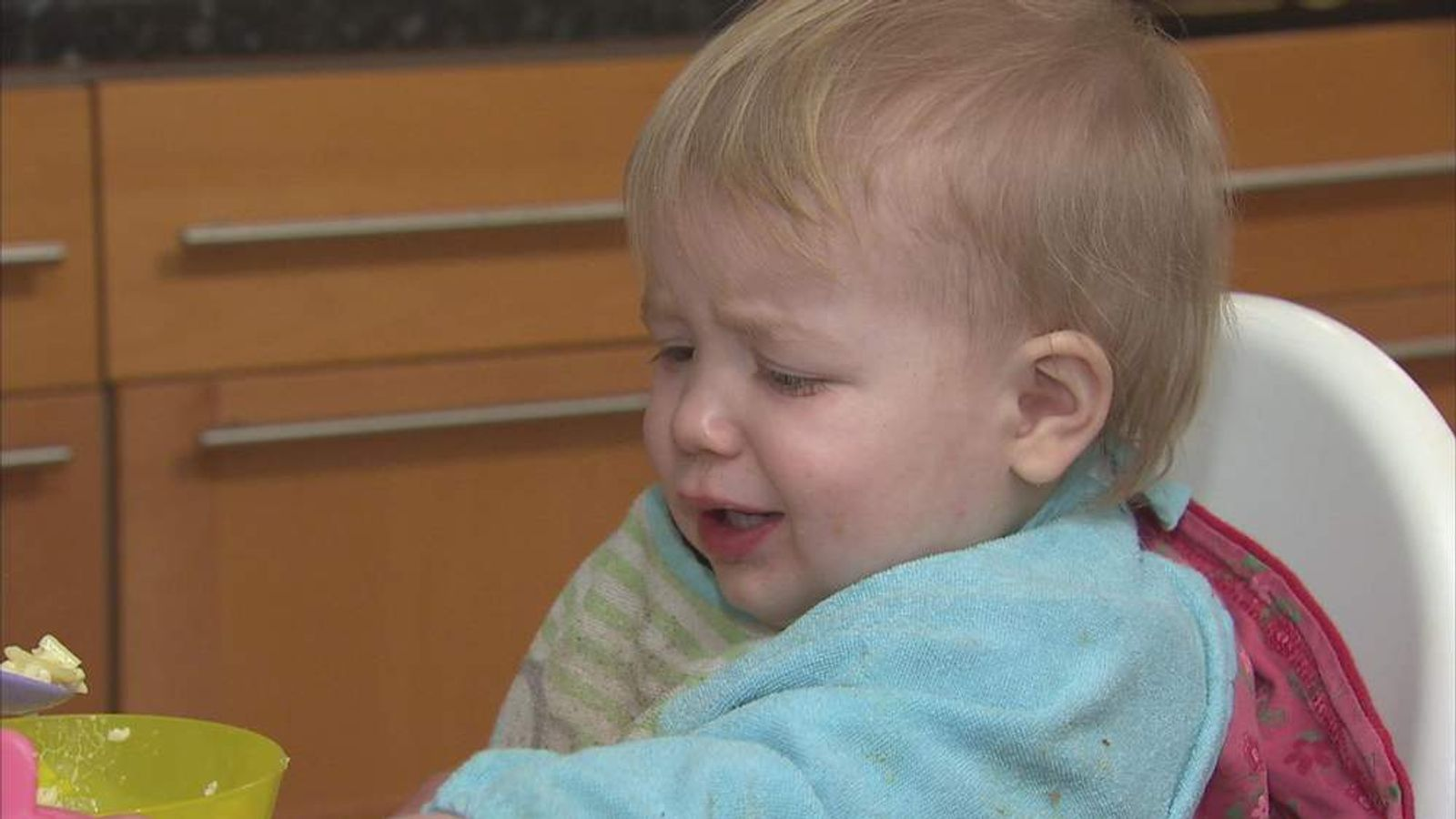 A toddler refusing food